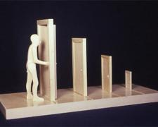 Man Opening Door, 2002, wood, 9 1/2 x 18 1/2 x 7 1/2""