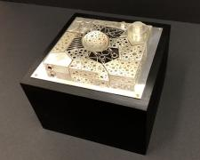 Jewelry Box #9, Aerial Landscape, 2019, 12 puzzle rings, wood, aluminum, fabricated sterling, 6 x 6 x 5""
