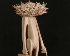 Man with Head in Nest (Large), 1990, pine wood, 50 x 21 x 24 3/4""