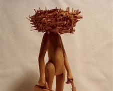 Man with Head in Nest (Small), 1980, pine wood, 9 1/4 x 3 1/2 x 3 1/2""