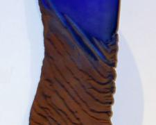 Blue Figure, 2005, cast and cut glass, fused steel, 21 x 9 x 2""