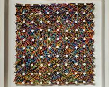"""We shall dance to our own accord, 2021, various colored strings woven through wood frame with pegs, 12 x 12"""""""
