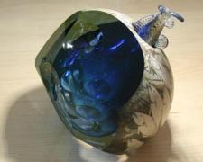From East to West, Fish Catcher #61, 2007, blown, sculpted glass with silver leaf engraving, electroplating, 8 1/2 x 9 x 8""