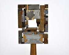 """Welcome New Member, 2014, printer's blocks, loom part, steel, 18 1/4 x 7 3/4 x 4"""""""