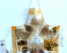 Star Child, 2012, iron relief prints, transfer prints on canvas apron, found objects, 42 x 28 1/2""