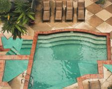 Poeyfarre Pool with Patio, 2009, handmade photo collage on panel, 26 x 19""