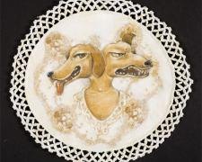"Two Dog Faces, 2010, acrylic and stitching on found fabric, 10"" round"