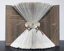 bride's journal, 2013, repurposed book sculpture, monotype, paper roses, embroidery thread, PVA, 8 1/2 x 11 x 4 1/2""