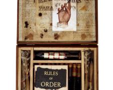 Rules of Order, 2007, box, darts, transparency, glass, book text, hydrometer, vilas, cork, oil, fish tooth, digital collage, 8 x 10 x 1""