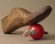 The Accusation of Inanimate Objects 2006 Assemblage - wood shoe last, croquet ball, carved figurine 5 3/4 x 11 3/4 x 6""