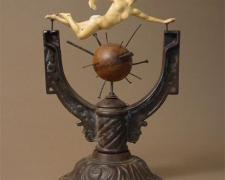 All Along the Way 2006 Assemblage - cast iron lamp base, cast figurine, croquet ball, miscellaneous hardware 17 1/2 x 11 1/2 x 9 1/2""