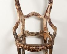 Apolitical Object, 2010, wooden chair, book and rotrogravure newspaper images, steel hook, 35 x 20 x 23 1/2""
