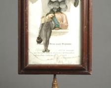 Remembrance 2007 Assemblage - framed religious certificate, book illustrations, lamp art, brass rod 20 1/2 x 11 x 7 3/4""