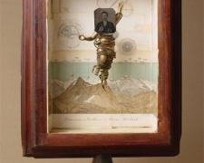 The Vision (No. 9) 2006 Assemblage - wood column base, book illustrations, tintype photograph, plastic figurine, cord, cast iron ceiling fixture part 20 1/4 x 13 1/2 x 8""