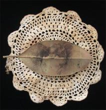 """The Beauty from Here 2011 Mixed media; intaglio on magnolia leaf, found objects 10 x 10"""""""