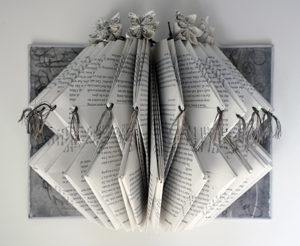 """legends, 2013, repurposed book sculpture, paper origami flowers, hand stitched with embroidery thread, PVA, 11 x 8 1/2 x 6"""""""