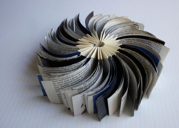 """new stage, 2012, reclaimed commercial material inserted into a folded form, 2 x 4"""" closed / 2 x 8"""" open"""