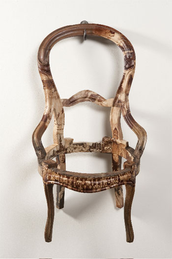 """Apolitical Object, 2010, wooden chair, book and rotrogravure newspaper images, steel hook, 35 x 20 x 23 1/2"""""""