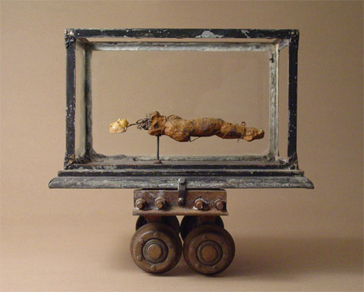 """Breach of Contract 2006 Assemblage - terrarium, ceramic figure study, plaster head, industrial carriage, wire 17 1/2 x 18 1/2 x 13 1/2"""""""