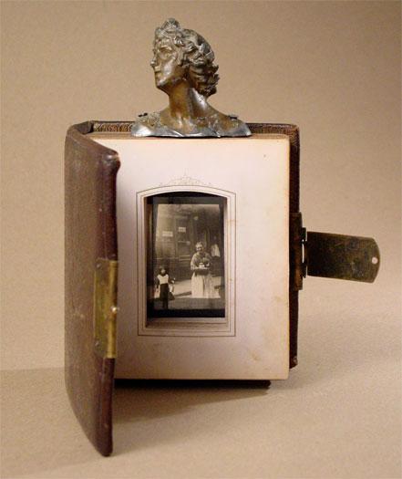 "Calcutta 2006 Assemblage - leather bound photo album, head from cast metal figurine, glass lantern slide 9 x 8 x 8"""
