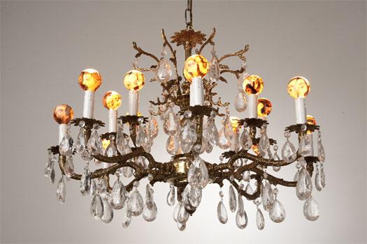 """Virtual Detachment, 2010, brass chandelier, light bulbs, book images, 21 x 28 x 28"""""""