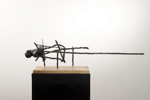 East End, 2009, cast metal bust, steel, wood base, 8 1/2 x 33 1/2 x 7""