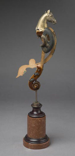 Poseidon's Hippocampus 2007 Assemblage - cast metal horse head, violin neck, sewing machine part, metal disc, decorative wood trim, steel rod, marble base 21 1/4 x 6 5/8 x 4 3/8""