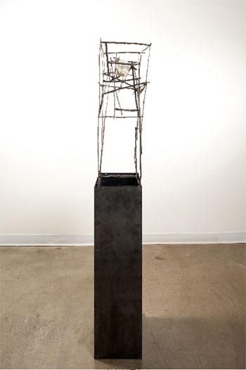 "Shiro, 2009, plaster figurine fragment, steel, 68 x 12 1/4 x 11 3/4"""