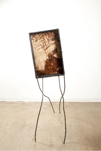 """Stranger, 2010, wood display case, book and rotogravure newspaper images, steel, 65 3/4 x 22 x 31 3/4"""""""
