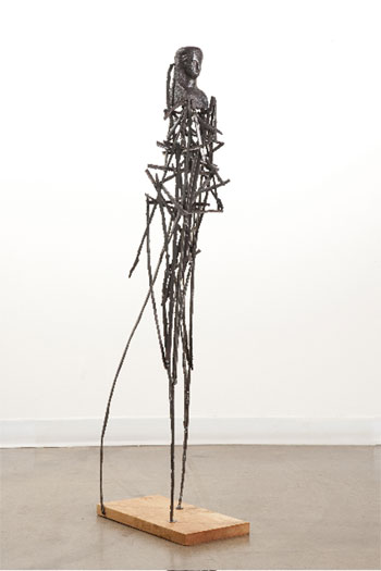 Zamalek, 2009, andiron head, steel, wood base, 47 x 15 3/4 x 7 1/2""
